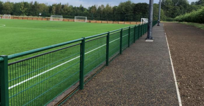 sports pitch with fence around it